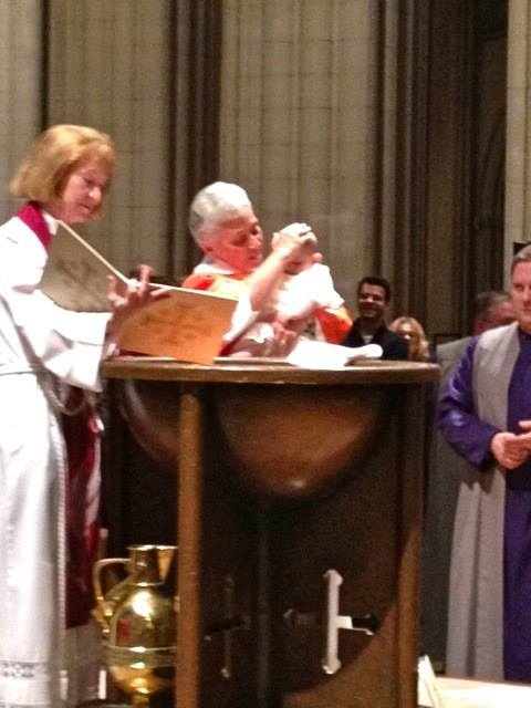 Getting baptized by Rev. Gina, Vicar Jan and Dean Gary.